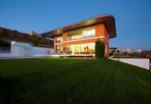 Landscape View Futuristic Orange House in Ankara Turkey by Yazgan Design Architecture 300x207 Desain Rumah Idaman yang Nyaman